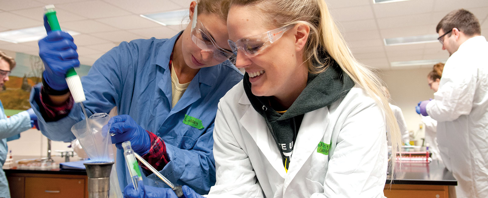 Two female students working in a lab.